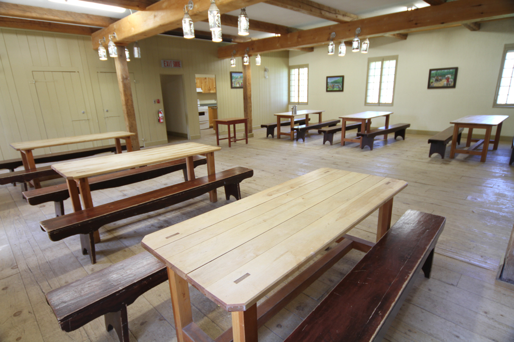 Bell House Common Room showing large tables with bench seating