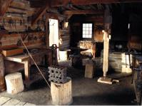 The Blacksmith Shop with wooden crates and tools
