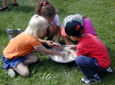 Young children mixing bread in bowl.jpg