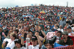 giant crowd of people ar a rock concert for as far as the eye can see