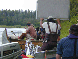 Filming voyageurs on river in canoe