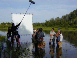 Filming voyageurs on standing in river