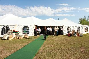 Outdoor massive tent with rolled out carpet for conference