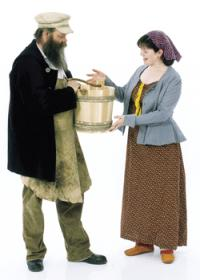 Tradesman and woman holding wooden bucket