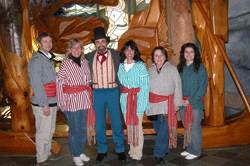 group of visitors wearing sashes and historic costumes