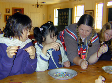 Children doing beadwork with reinactor.jpg