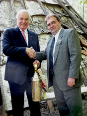 General Manager giving tin lantern to diplomat in front of wigwam