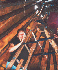 Woman constructing Wigwam.png