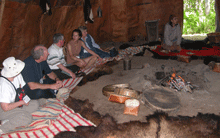 Visitors sitting in Wigwam.png
