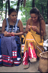 Two Ojibwe girls making crafts.png