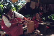 Ojibwe women making mukuk baskets.png