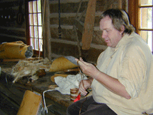 Master canoe builder working in his shop