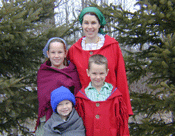Family of young volunteers in costume